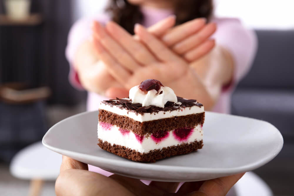 Woman saying no to cake