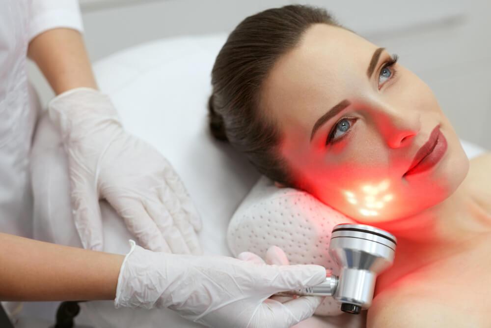 Woman having LED treatment
