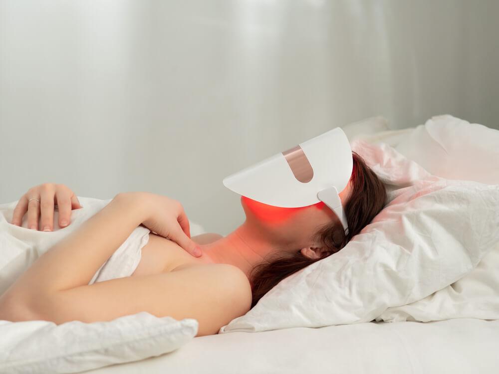 Woman wearing LED mask