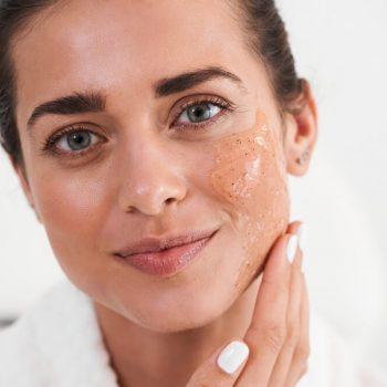 Woman applying peeling gel