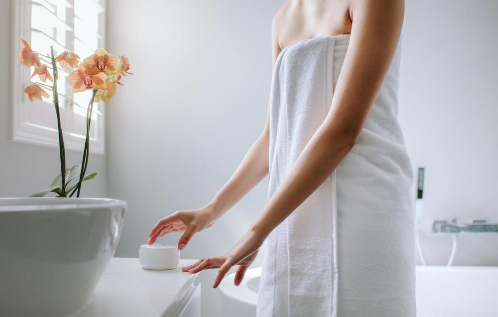 Woman applying day cream