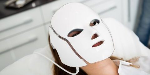 Woman wearing LED mask